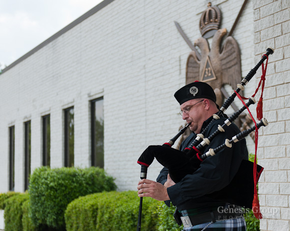 Bagpiper warms up in from of Charlotte Scottish Rite building